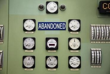"Meters used to monitor the turbine generator were labeled ""abandoned"" in the control room."